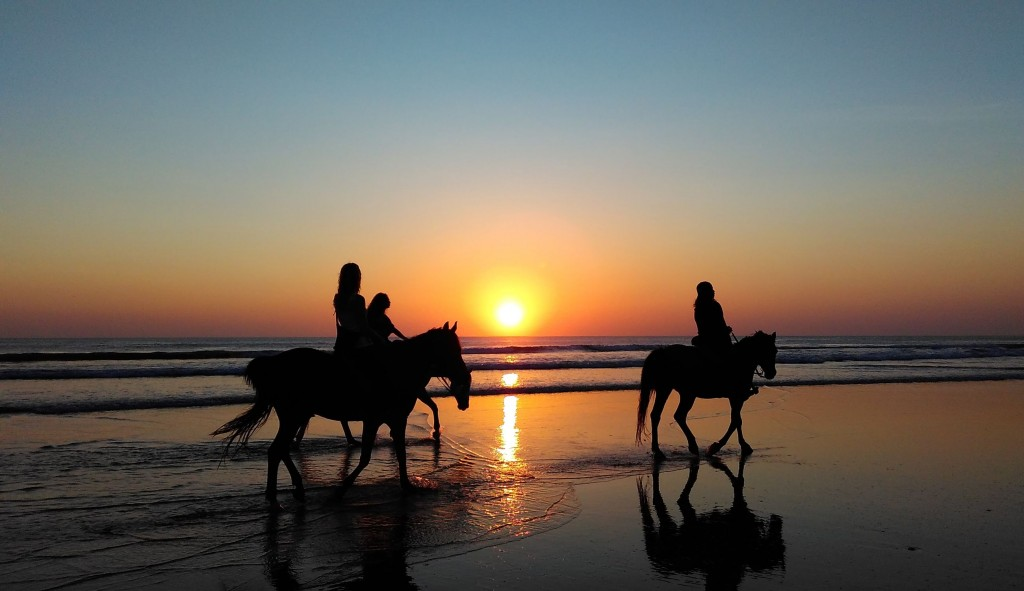 Sunset riding on the beach